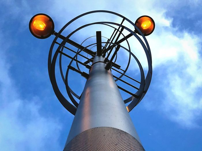 Street Art Getting Inspired Visual Creativity vanishing point Modern Light City Geometric Architecture Geometric Shape Sky Low Angle View Cloud - Sky No People Metal Architecture Built Structure Street Light Circle Lighting Equipment Geometric Shape Illuminated Sphere Blue