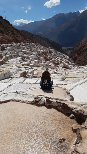 Rear view of woman sitting at salt mine