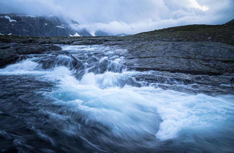 Wild river flowing through a mountain area in hardangervidda, norway.