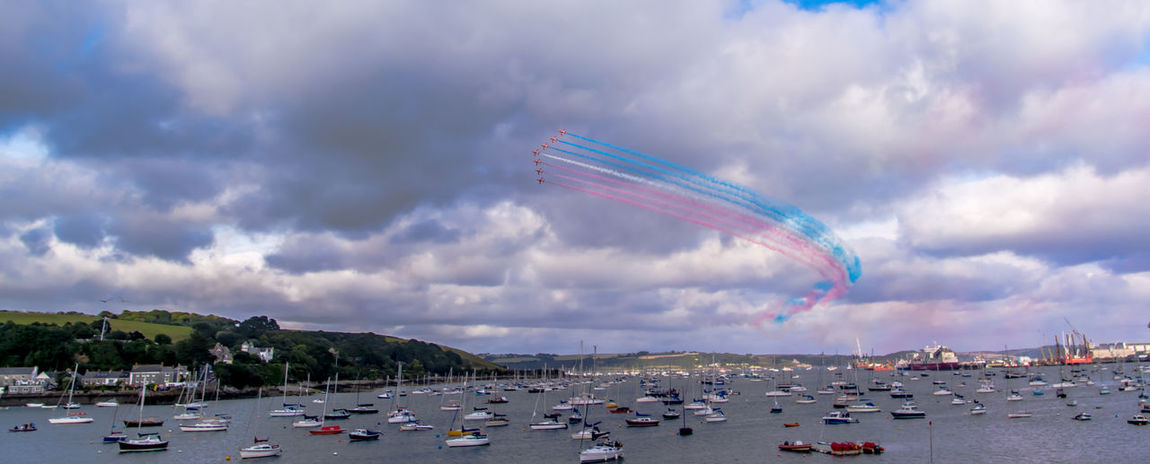 Red Arrows flying over Falmouth during Falmouth Week 2016 Aerobatics Air Display  Amazing Blue Cloud Cloud - Sky Cloudy Falmouth Falmouth Harbour Falmouth Week Flying Formation Flying Multi Colored Outdoors Red Arrows Red Arrows Air Display Redarrows Royal Air Force Display Team Sky