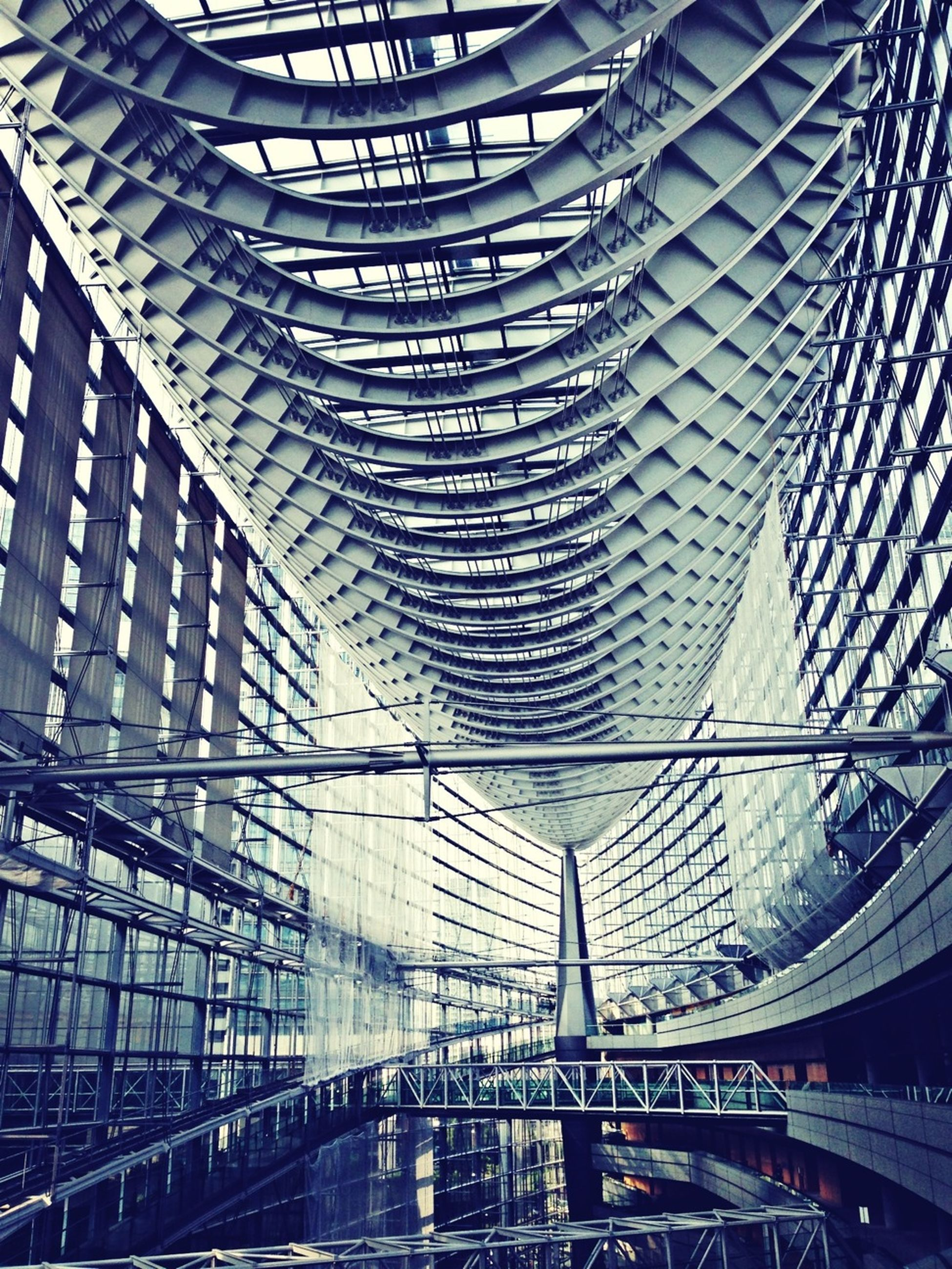built structure, architecture, modern, indoors, building exterior, city, low angle view, ceiling, pattern, glass - material, metal, building, incidental people, transportation, architectural feature, high angle view, full frame, day, office building, capital cities