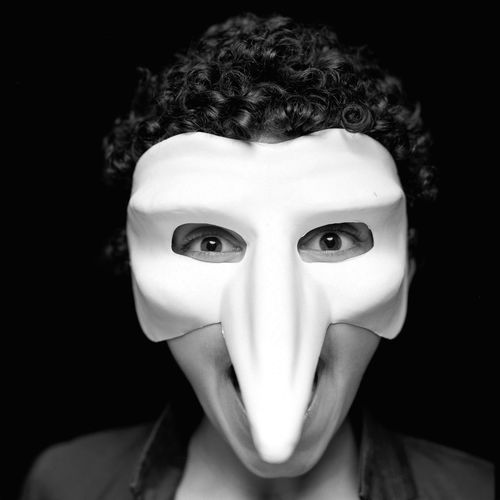 B. Portrait EyeEm Film Photography Headshot One Person Looking At Camera Front View Indoors  Close-up Black Background Disguise Real People Mask - Disguise Mask Studio Shot