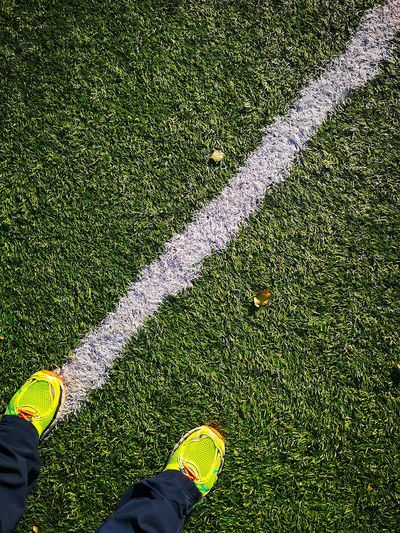 Follow the line... Diagonal Diagonal Lines Soccer Player Soccer Field Soccer Field Lines Grass Sneakers Sportshoes Low Section Men Standing Soccer Field Human Leg Shoe High Angle View Grass Green Color Human Feet Footwear Ground Feet Canvas Shoe LINE Marking Personal Perspective Yard Line - Sport Playing Field