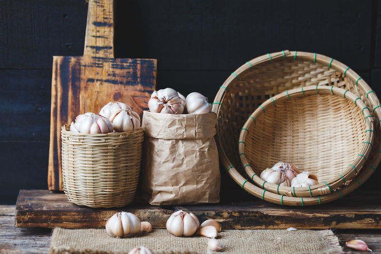 High angle view of garlic in basket on table