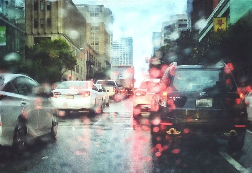 City Car Rain Street Transportation Land Vehicle City Street Wet Mode Of Transport Building Exterior Architecture Traffic Rainy Season Road City Life Rush Hour Water Day Outdoors No People IPhone 7 Plus L. Jeffrey Moore Adapted To The City The City Light