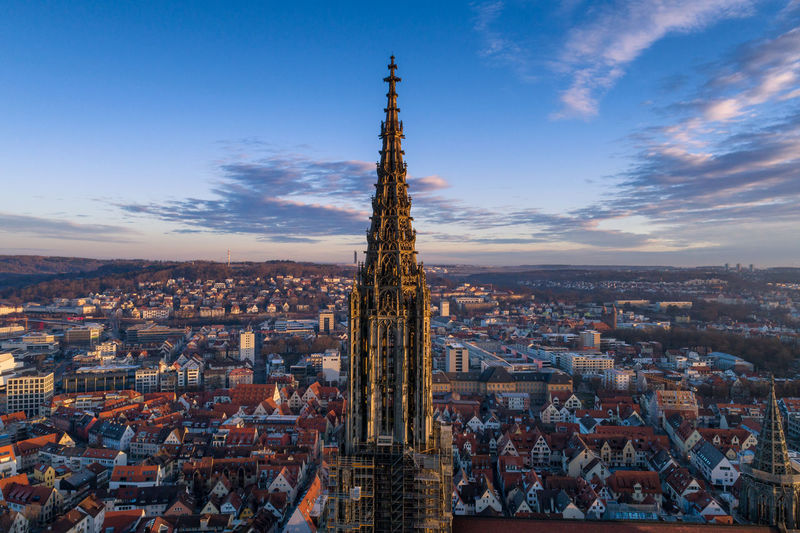 Aerial shot taken with a drone of Ulm Minster at sunrise Bavaria Cathedral Cityscape Drone  German Münster Panorama Skyline Ulm Aerial Aerial View Architecture Best  Dji Europe Flying Germany Minster Outdoors Summer Sunrise Sunset Tower Travel Ulmer Münster