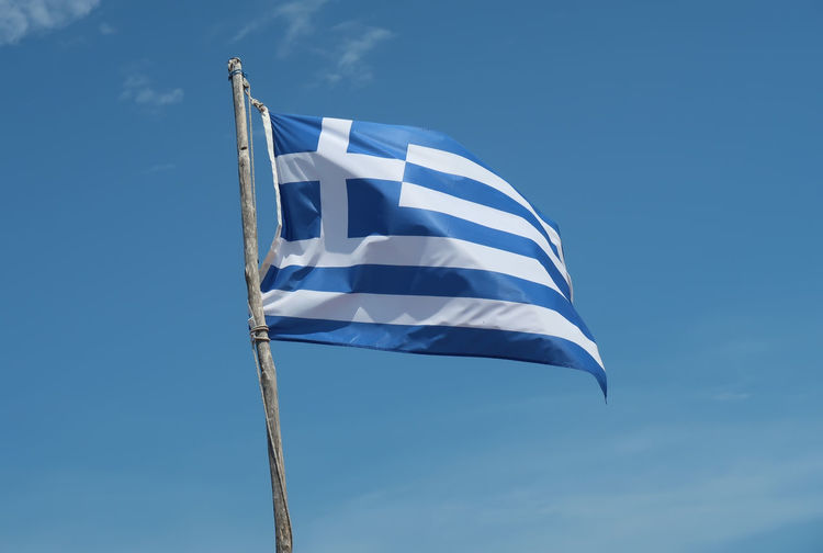 Flag of Greece Sky Blue Travel Flag Sunlight Waving Wind Shape Patriotism Greece Clear Sky Patriotic Pole Striped Hellas No People GREECE ♥♥ Ellada  White Color Travel Destinations Greece Flag Greece Photos National Icon Flag Of Greece Outdoors Freedom