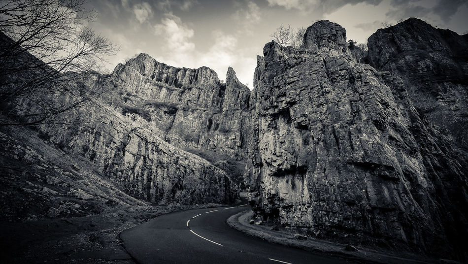 Cheddar Gorge Beauty In Nature Cloud - Sky Country Road Day Empty Road Geology Gorge Landscape Nature No People Non-urban Scene Road Rock - Object Rock Formation Scenics Sky Tranquil Scene