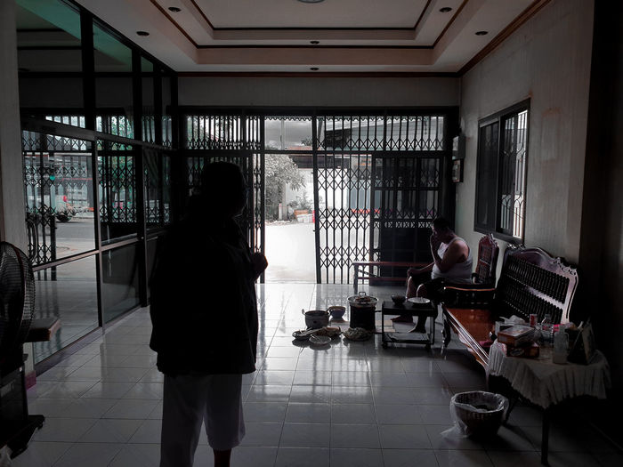 Woman walking on tiled floor