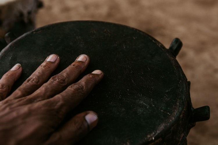 High angle view of hand on a drum
