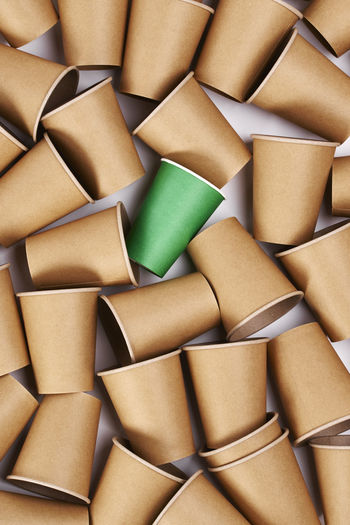 Green disposable mug among paper mugs Mug Disposable Paper Disposable Cup Eco Biodegradable Organic Carton Cardboard Nature Concepts Take Out Food Drink Coffee Cafe Background Recycling Plastic Zero Waste Ecology Environmental Conservation Environment Protection Environment Care Earth Protection Ecosystem  Environmental Damage Problems Environmental Issues Global Warming Eco Friendly Social Issues Group Of Objects Stack No People