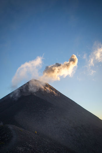 Mt Fuego erupting at sunset, Guatemala. Day Emitting Erupting Fuego Geology Guatemala Lava Mountain Nature No People Outdoors Physical Geography Power In Nature Sky Smoke - Physical Structure Sunset Volcanic Landscape Volcano