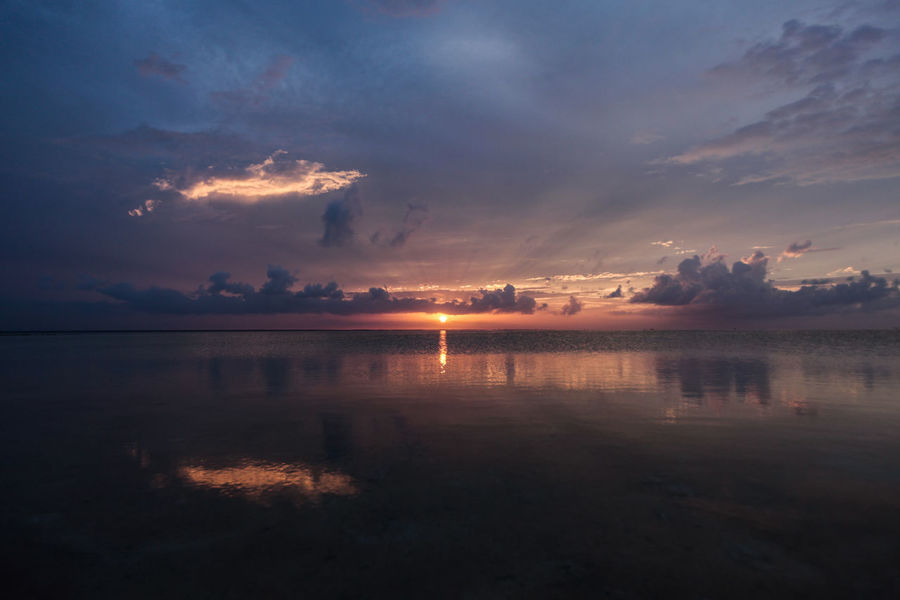 Beauty In Nature Calm Cloud Cloud - Sky Colors Of The Year Dark Dramatic Sky Eye Horizon Over Water Lake Moody Sky Nature No People Orange Color Outdoors Reflection Scenics Sea And Sky Sky Sun Sunset Tranquil Scene Tranquility Water Weather