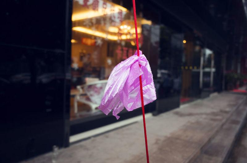 Close-up of umbrella at night