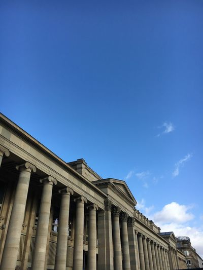 Low angle view of government building against blue sky