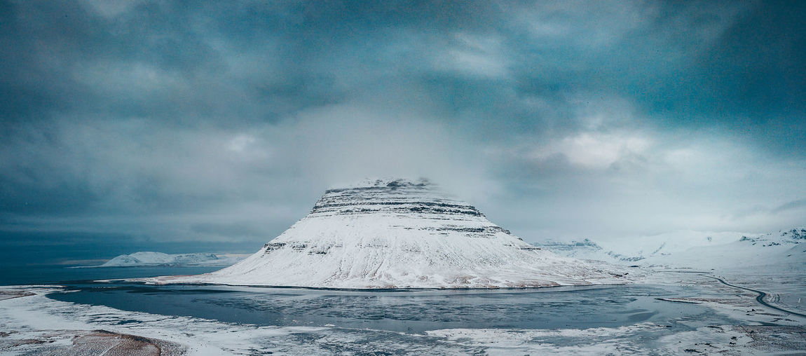 Kirkjufell, Iceland. Kirkjufell is a 463 m high mountain on the north coast of Iceland's Snæfellsnes peninsula, near the town of Grundarfjörður. Aerial Shot DJI X Eyeem Drone  Iceland Iceland Memories Icelandic Nature Kirkjufell Winter Aerial Aerial View Beauty In Nature Cloud - Sky Cold Temperature Day Environment Extreme Weather Iceland Trip Iceland_collection Idyllic Landscape Mavic Mavic Pro Mountain Nature No People Non-urban Scene Power In Nature Scenics - Nature Sky Snow Snowcapped Mountain Tranquil Scene Tranquility White Color Winter