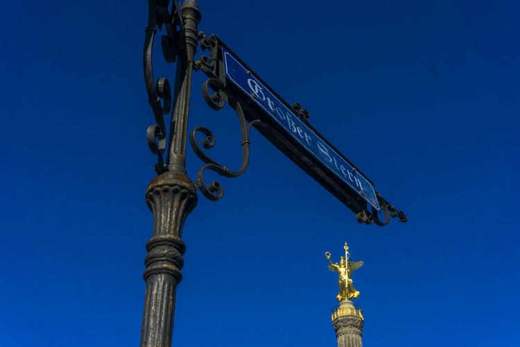 Grosser Stern road sign with Victory Column in Berlin, Germany Architecture Berlin Blue Built Structure Clear Sky Color Image Day Germany🇩🇪 Großer Stern Horizontal No People Outdoors Road Sign Sky Victory Column