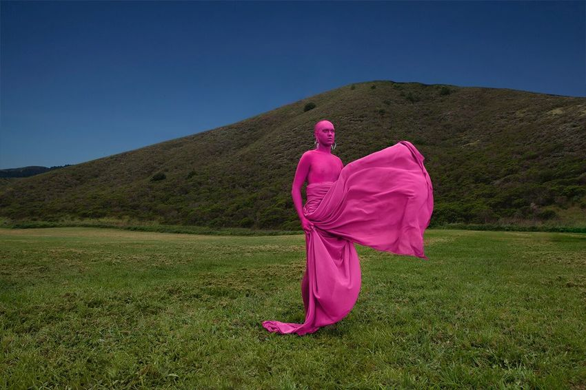 Model: Abominatrix. This series discusses how far we as humans have distanced ourselves from nature, causing us to sometimes feel out of place in the wilderness. Our involvement in manufactured things can make us feel like a foreign object in a landscape. 🏞 Pink Color Full Length Outdoors Traditional Clothing Grass Nature Landscape Young Adult Adult People Adults Only Sky Day The Great Outdoors - 2017 EyeEm Awards