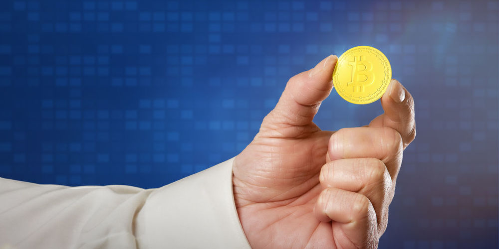 Digital Crypto Currency: Businessman holding a Bitcoin between his fingers Business Currency Finances Golden Shiny Bitcoin Business Finance And Industry Coin Cryptocurrency Digital Finance Holding Human Body Part Human Hand Indoors  Mining Money One Person