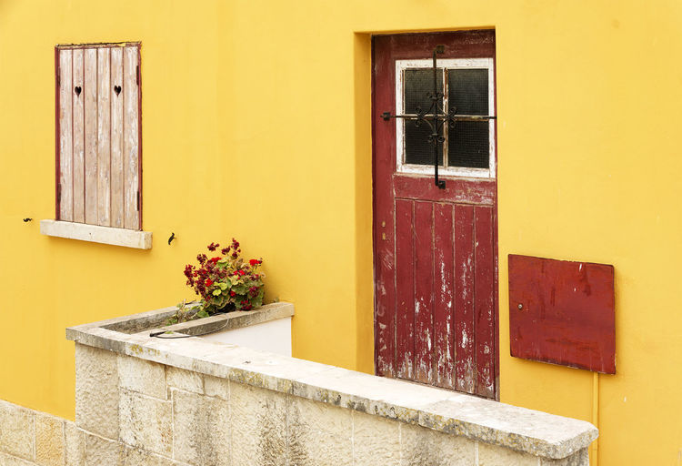 Close-Up Of Yellow Wall With Closed Window