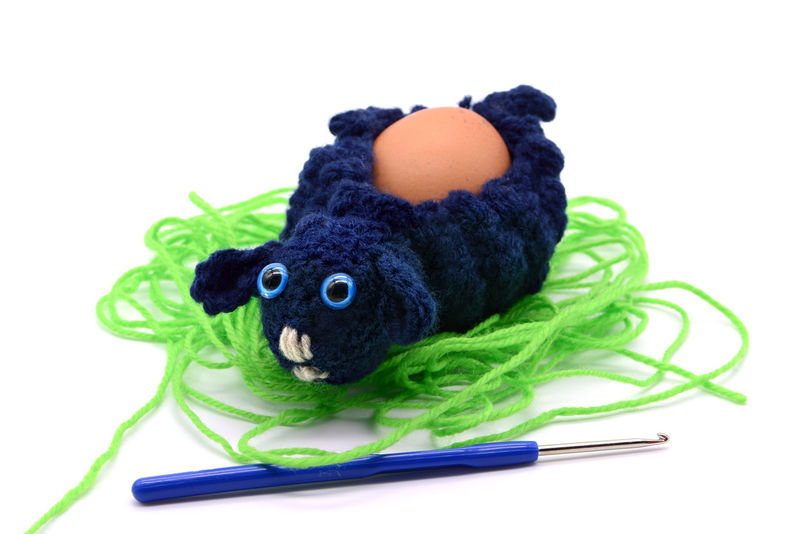 crochet blue Easter lamb egg cup made of wool with crochet hook, white isolated background Crocheting Easter Easter Egg Easter Ready Easter Eggs Egg Cups Crochet Crochet Hook Crocheted Crocheting Is My Hobby Crochetlove Easter Lamb Easter Sheeps Egg Cup Eggcup Green Color No People Sheep Studio Shot Stuffed Toy White Background