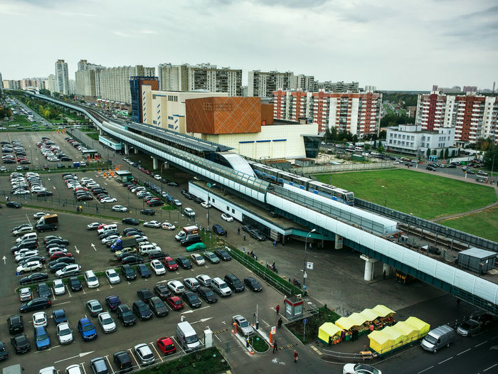 High angle view of vehicles at parking lot in city