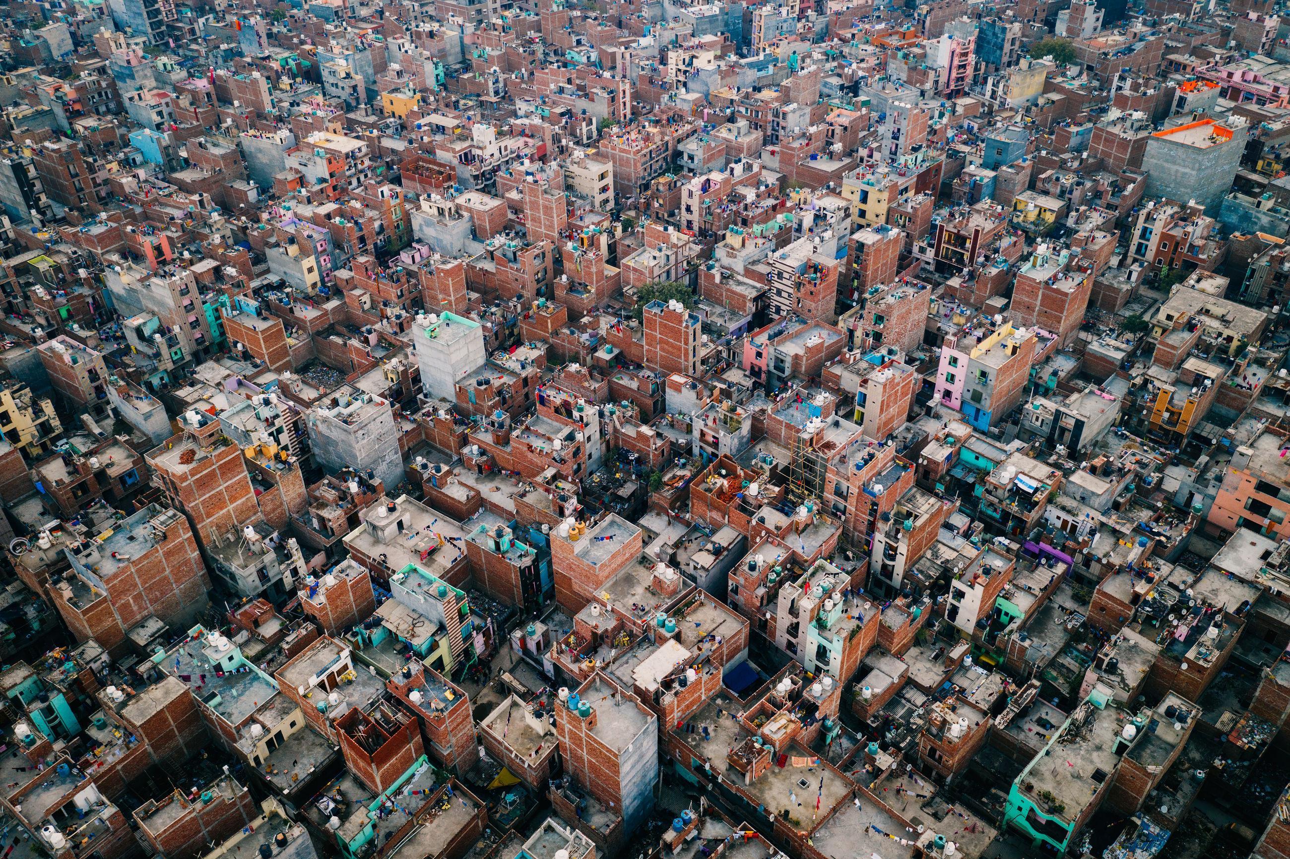 architecture, building exterior, built structure, city, cityscape, crowd, high angle view, residential district, aerial view, crowded, building, backgrounds, full frame, day, travel destinations, city life, outdoors, nature, community, townscape