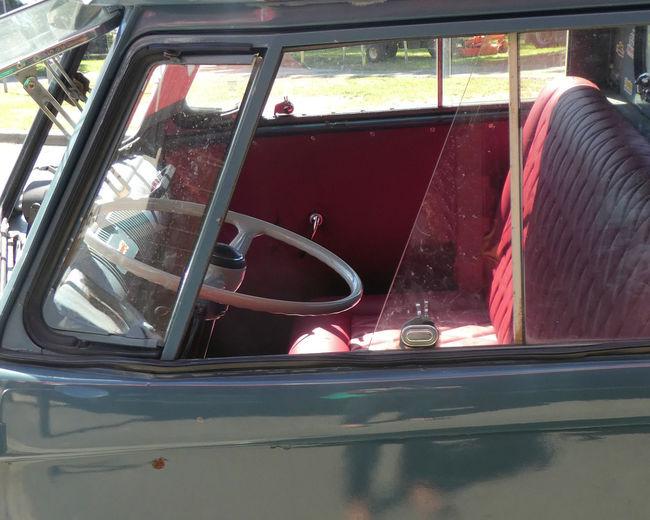 Man working on car window