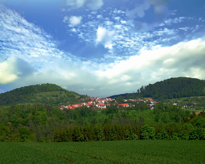 View of Weiler, a rural suburb of Rottenburg am Neckar, Germany Rottenburg Am Neckar Architecture Beauty In Nature Building Exterior Built Structure Cloud - Sky Day Germany Grass Green Color Growth Landscape Mountain Mountain Range Nature No People Outdoors Scenics Sky Tranquil Scene Tranquility Tree Weiler