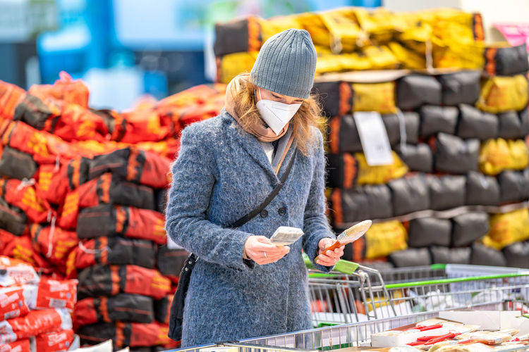 Midsection of woman standing in market during winter