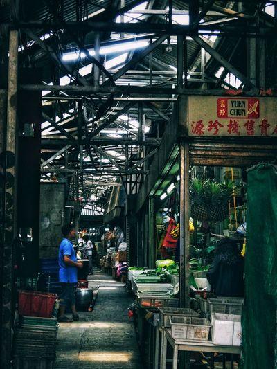People at illuminated market in city