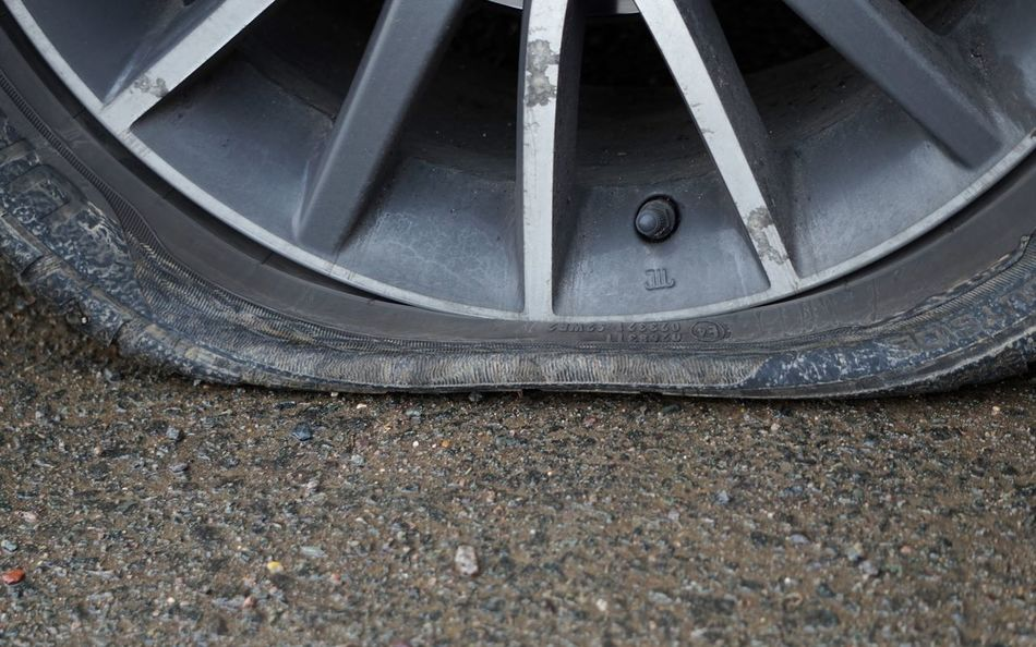 Alloy Wheels Bad Day Close-up Day Flat As A Pancake Flat Tyre Ground Ground Level View Land Vehicle Metal No People Outdoors Tire Tyre Valve Valve Wheel Road Farm Land Happy New Year, Really? Happy New Year Happy New Year!