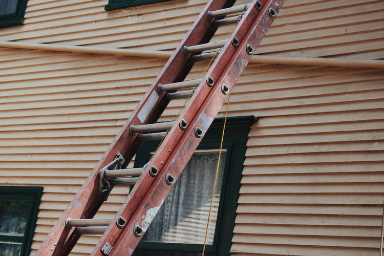 Ladder Against Wall Outside House