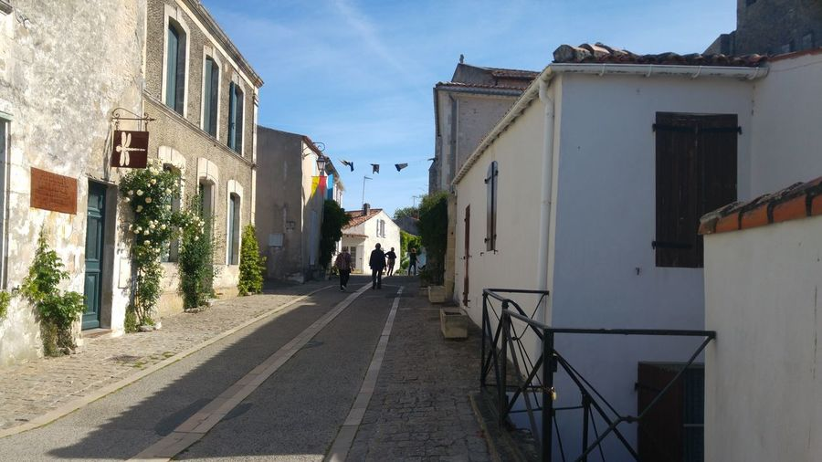 Architecture Sky Building Exterior People Adult Adults Only Day Outdoors Only Women One Person France Photos Vacations Charentemaritime Mornacsurseudre Francetourisme Landscape Charente-Maritime Architecture Blue Sunny Streetphotography