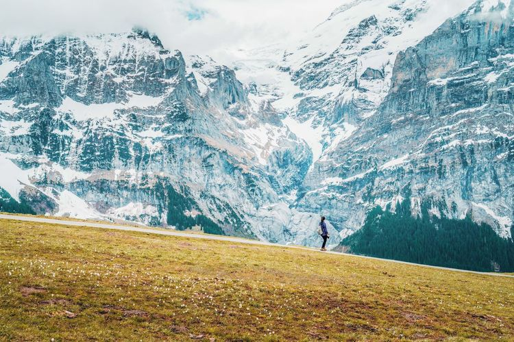 Woman looking at snowcapped mountain