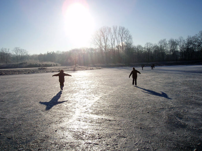 Boys skating on a frozen pond. Ice Skating Winter Boys Cold Temperature Outdoors Snow Netherlands Hilversum Shadows Silhouettes Winter Wonderland
