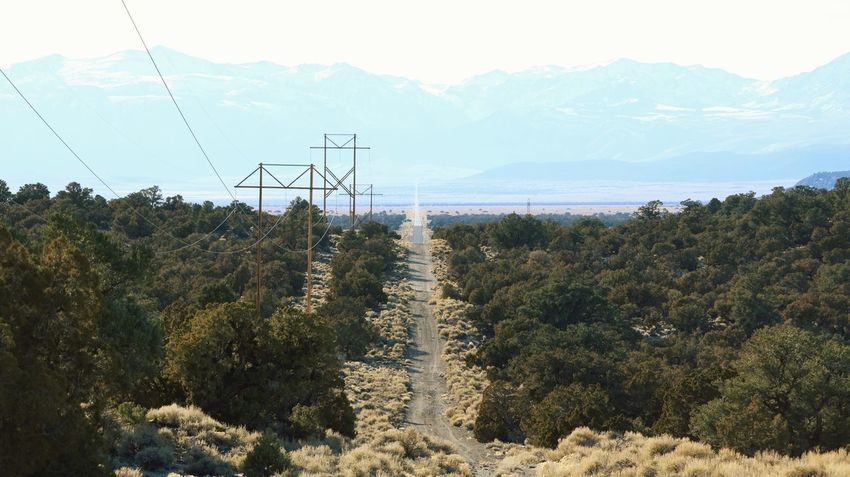 Pole line road Power Lines Pole Line Dirt Road Cable Landscape Electricity  Mountain Fuel And Power Generation Electricity Pylon Tree No People Mountain Range Outdoors Nature Day Beauty In Nature Sky Scenics