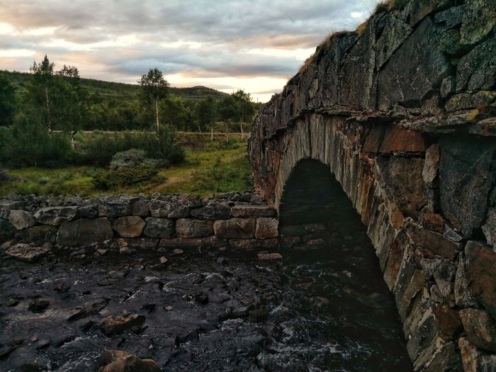 What people passed here, what stories do you see? HDR Norway Huawei Norwegian Architectural Detail Bridge Old Technology Bridge Detail History Ancient Architecture Sky Built Structure Cloud - Sky Stone Material