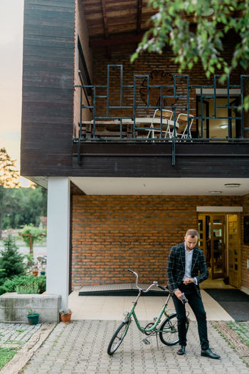 Man Stylish Adult Architecture Bicycle Building Building Exterior Built Structure Bycicle Casual Clothing City Day Front View Full Length Lifestyles Man Fashion Men One Person Outdoors Real People Retro Style Retro Styled Style Style And Fashion Transportation Young Adult Young Men