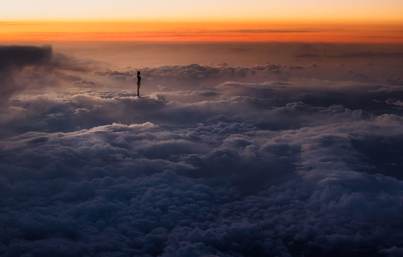 above the clouds Above Above The Clouds Beauty In Nature Cloud - Sky Day Flying Nature One Person Outdoors People Real People Scenics Silhouette Sky Sky And Clouds Sunset Tranquility Travel Destinations Travel Photography Lost In The Landscape Connected By Travel