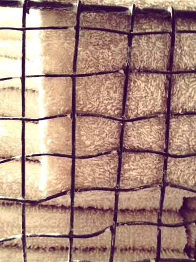 Towels in metal basket Close-up Towels Basket Different Materials Full Frame Pattern No People Textured  Bathroom Interior Different Textures