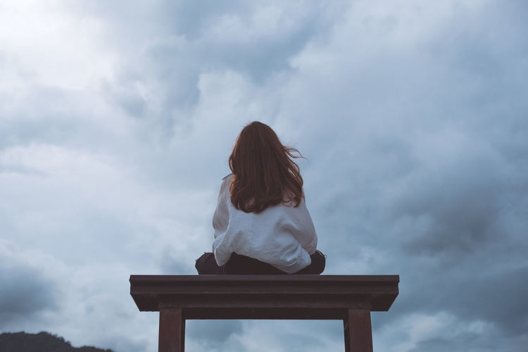 Alone woman with nature Back Woman Adult Background Bench Casual Clothing Cloud - Sky Contemplation Day Hairstyle Innocence Leisure Activity Lifestyles Low Angle View Nature One Person Outdoors Real People Rear View Seat Sitting Sky Solitude Women