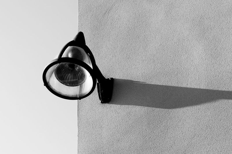 Close-up of wall lamp with shadow
