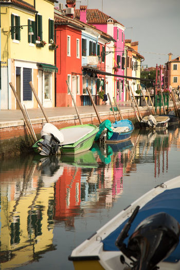 A Day in Burano Beautiful Burano Boats And Moorings Canal Colourful Houses Day Fishing Boats Outdoors Reflection Travel Destinations Travel Photography Water Waterfront
