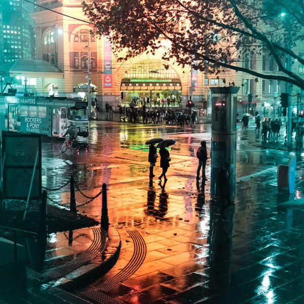 Wet night in Flinders Street station. Cityscape City Life Melbourne Melbourne City Illuminated Night Melbournecbd Orange And Blue Night Skyline EyeEm Selects Night Lights Nightphotography City Tones Wet Night Rainy Night Orange Color City Street Umbrella Pedestrian Silhouette City Water Men Reflection Wet Women Architecture Building Exterior Sky Built Structure
