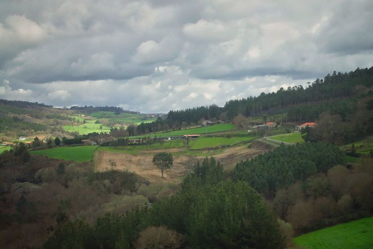 Environment Outdoors Train From The Train Window Landscape Mountain Mountain Range SPAIN No People Traveling Tourism Cloud - Sky Scenics - Nature Agriculture Rural Scene Field Land Beauty In Nature Green Color Plant Springtime Beautiful Nature Top View Spring Farmland