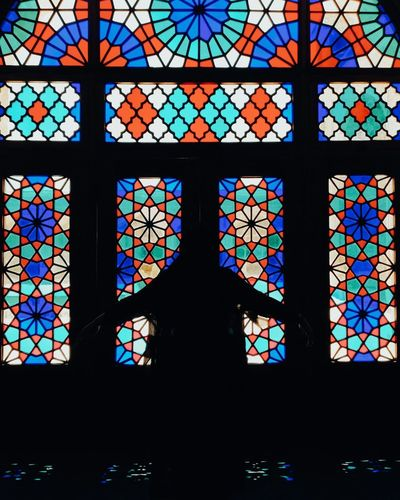 Multi colored glass window of building