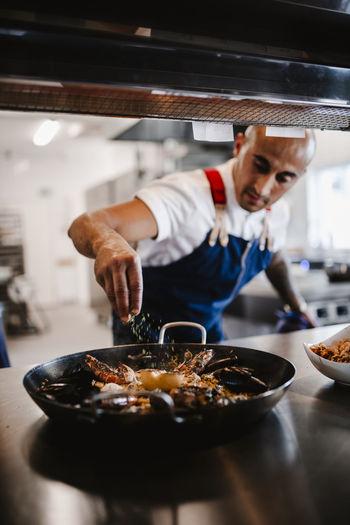 Man preparing food in restaurant