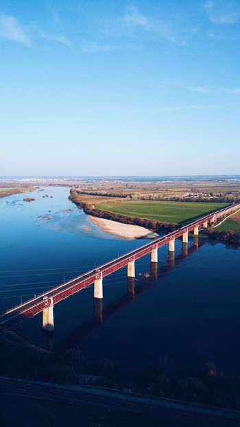 Portas do Sol, Santarém, Portugal Reflection Transportation River Harbor Bridge - Man Made Structure Water City Outdoors Illuminated Sky Horizon Over Water Cityscape No People Day Portugal Santarém Bridge Nature Transportation Architecture Road Red Cloud - Sky