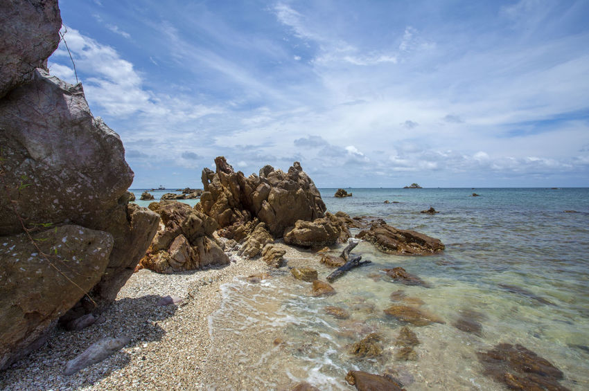 Beach, sea and rock formation in the Island with the bluesky at brightday Sunlight Beach Beauty In Nature Brightday☀ Cloud - Sky Day Horizon Over Water Nature No People Outdoors Rock - Object Rock Formation Scenics Sea Sky Tranquility Travel Destinations Water